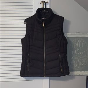 black MK vest